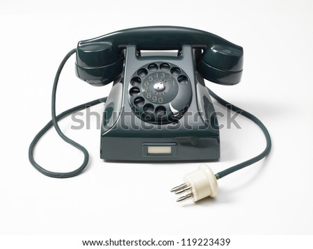 old green phone to wheel on a white background - stock photo