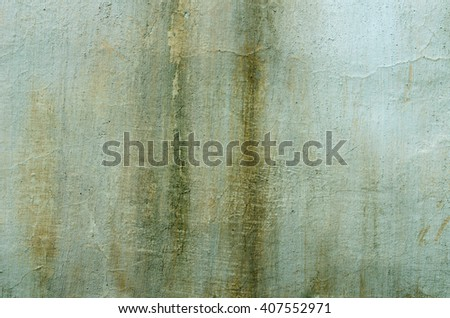 Old green plaster with traces of the impact of bad weather. textural composition - stock photo