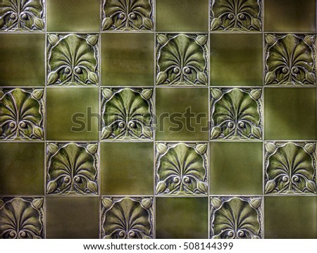 Old green Victorian decorative tiled background.