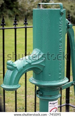 old green village water pump