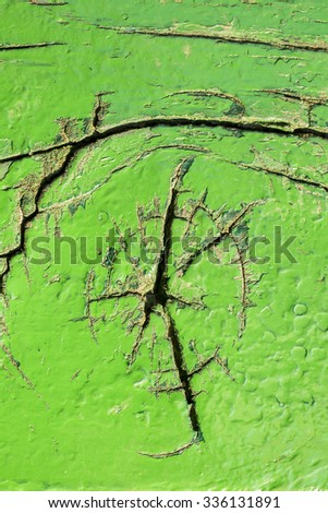 Old green wooden boat hull with paint peeling off. Tropical theme, backgrounds and textures - stock photo
