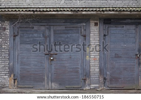 Old Grey Garage Door at a old house  - stock photo
