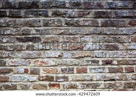 Old grey grunge brick wall background - stock photo