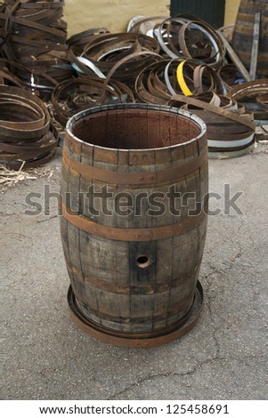 Old grey grungy wine barrel - stock photo
