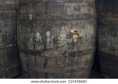 Old grey grungy wine barrels - stock photo