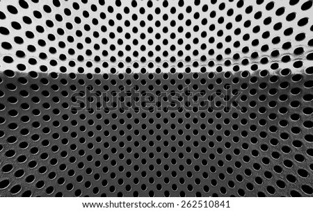 Old grey metal grille with a black hole. - stock photo