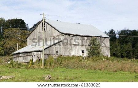 old grey weathered barn in the country