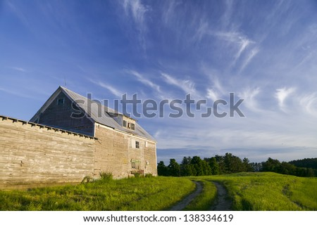 Old grey weathered barn, Stowe, Vermont, USA - stock photo