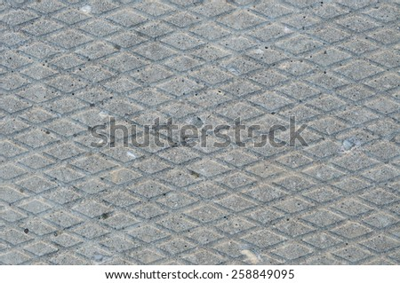Old grey weathered concrete plate background rough grunge abstract cement tile texture diagonal groove pattern macro closeup grooved detailed horizontal textured gray sidewalk walkway pathway - stock photo