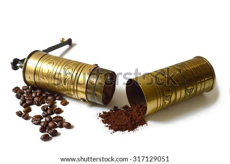 Old grinder, coffee beans and ground coffee isolated on white background - stock photo