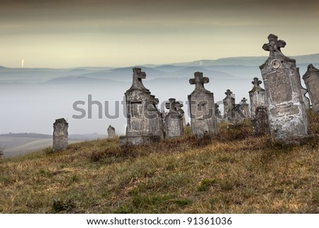 Old group of tombstones ruin on the hill, Hungary - stock photo