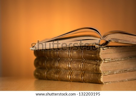 old grunge books on wooden table with free space for your text - stock photo