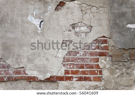 Old grunge brick wall and plaster - stock photo