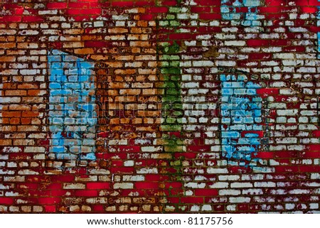 Old grunge brick wall painted white, blue, and Green - stock photo