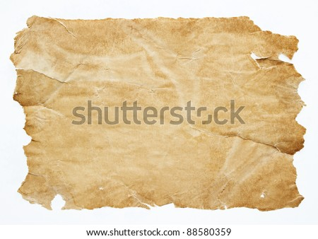 Old grunge brown paper sheet isolated on white background - stock photo