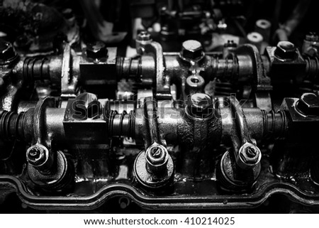 old & grunge car engine inside view, black and white filter - stock photo