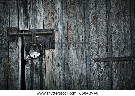 Old grunge door lock - stock photo
