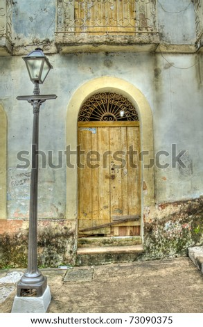 Old Grunge Door of Colonial House with Lamp Post - stock photo
