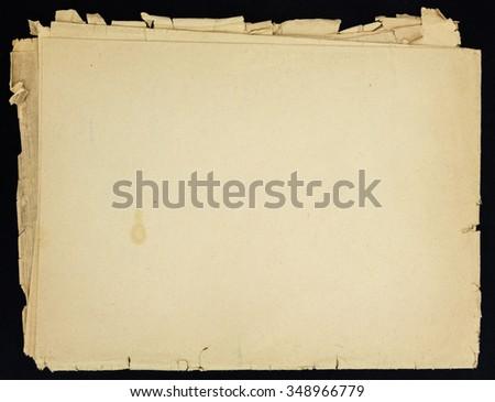 Old grunge folded paper sheet, isolated on black background. - stock photo