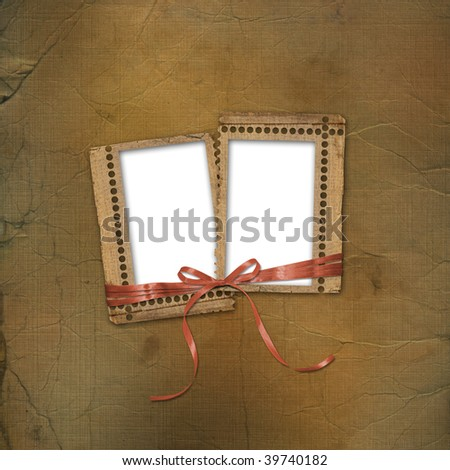 Old grunge frames with ribbons and bow on the abstract background - stock photo