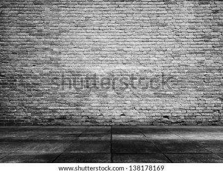 old grunge interior with brick wall, black and white background - stock photo