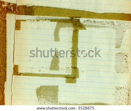 Old grunge paper with lines and glue stains - stock photo