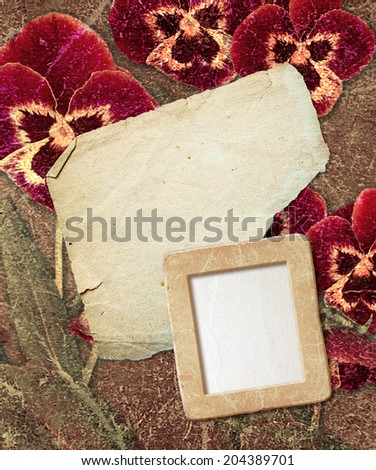 Old grunge photo frame with pansy and paper for letter