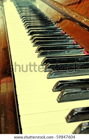 Old grunge piano with ancient note sheets texture - stock photo