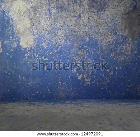 old grunge room with concrete wall, blue background - stock photo