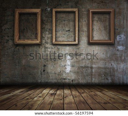 Old grunge room with picture frames - stock photo