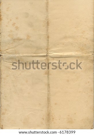 Old grunge, stained yellowed paper