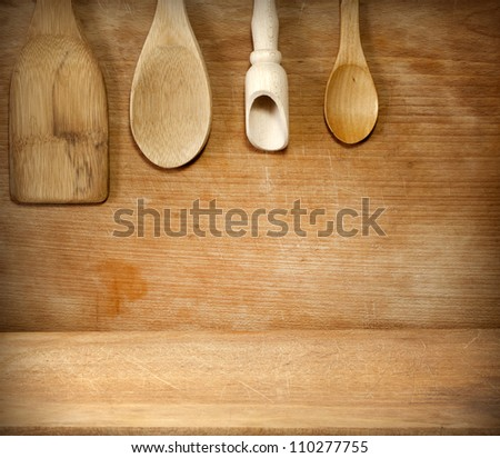 Old grunge vintage wooden cutting kitchen desk board with spoon - stock photo
