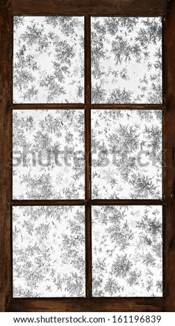 Old grunge wooden window, frosted over. - stock photo