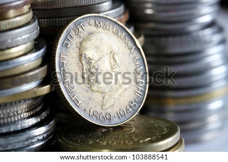 Old grungy brass metal indian currency coin with Mahatma Gandhi(Father of Indian Nation) face - stock photo
