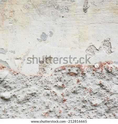 Old grungy concrete wall fragment as an abstract background composition - stock photo