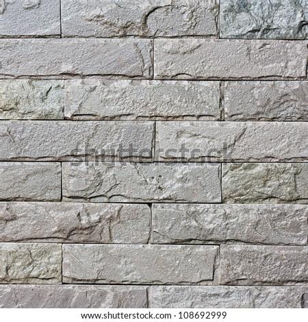Old grungy gray brick wall texture - stock photo