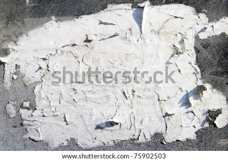 Old grungy paper on wall background - stock photo
