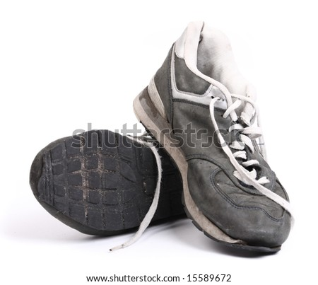 Old grungy Running Shoes isolated on white background - stock photo