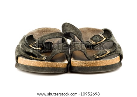 Old grungy sandal isolated on white background - stock photo