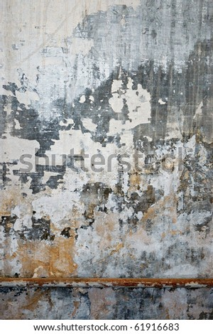 Old grungy wall texture. Peeling stained surface background. - stock photo