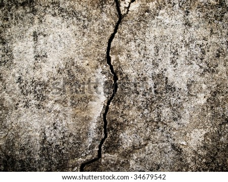 old grungy wall with large cracks