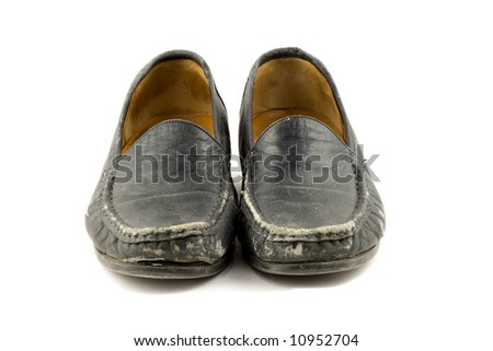 Old grungy womens shoe isolated on white background - stock photo