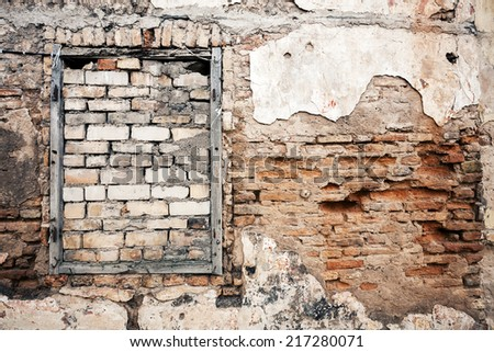 Old gungy wall with boarded up window  - stock photo