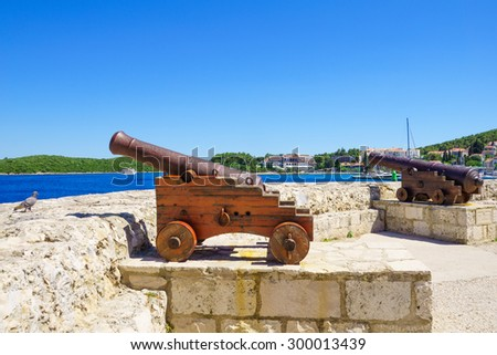 Old guns on the walls of the old town, in Korcula, Dalmatia, Croatia - stock photo