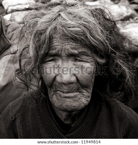 old gurung lady, annapurna, nepal - stock photo