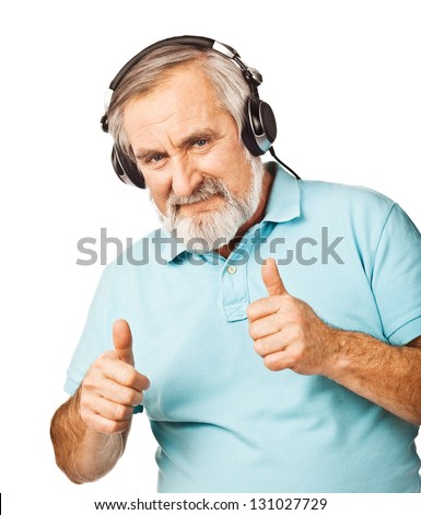 Old guy listening to music with headphones on white background - stock photo