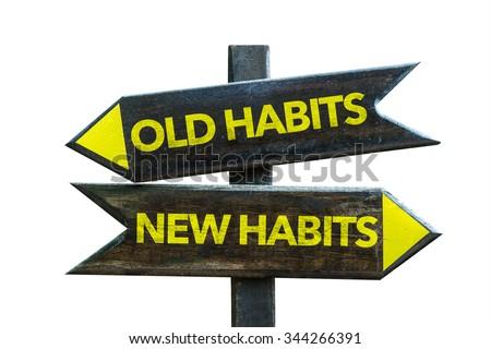 Old Habits - New Habits signpost isolated on white background - stock photo