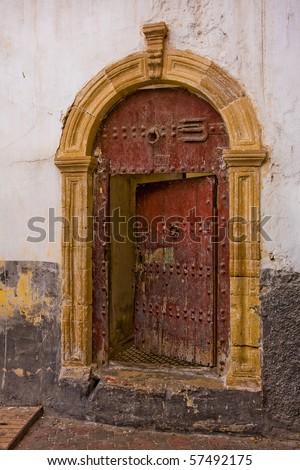 Old half-opened door in Casablanca, Morocco. - stock photo
