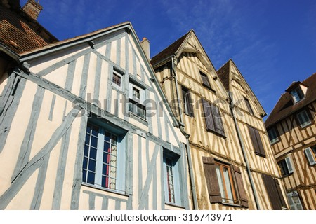 Old half timbered colorful houses in medieval town of Auxerre (Burgundy, France).  - stock photo