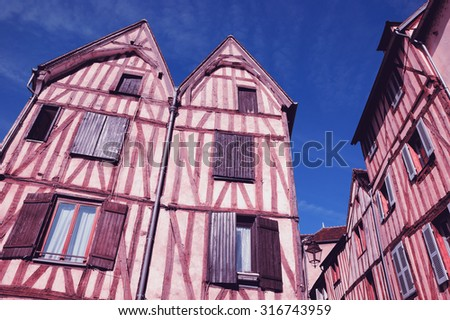 Old half timbered colorful houses in medieval town of Auxerre (Burgundy, France).  Toned photo. - stock photo